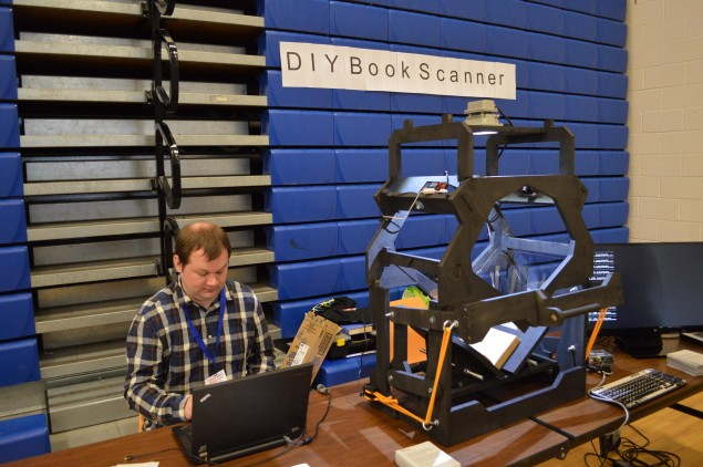 This DIY book scanner works by taking a hi-res picture of both pages of a book simultaneously while flattening them against a Plexiglas screen.