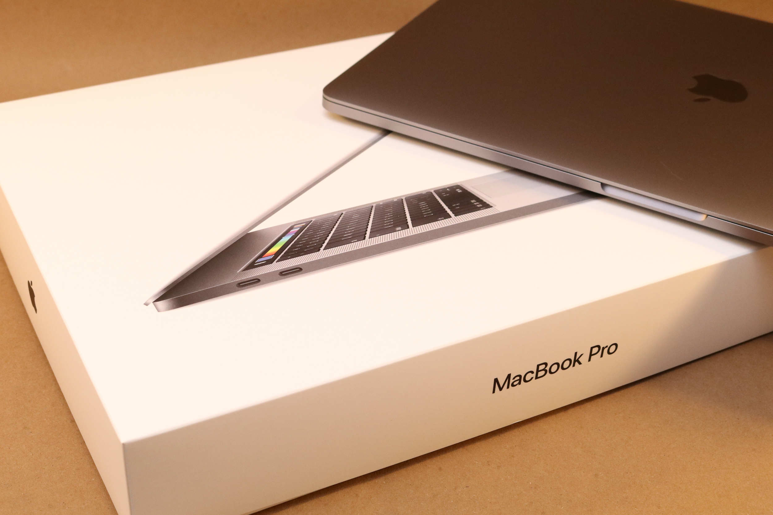 The MacBook Pro box w/ laptop